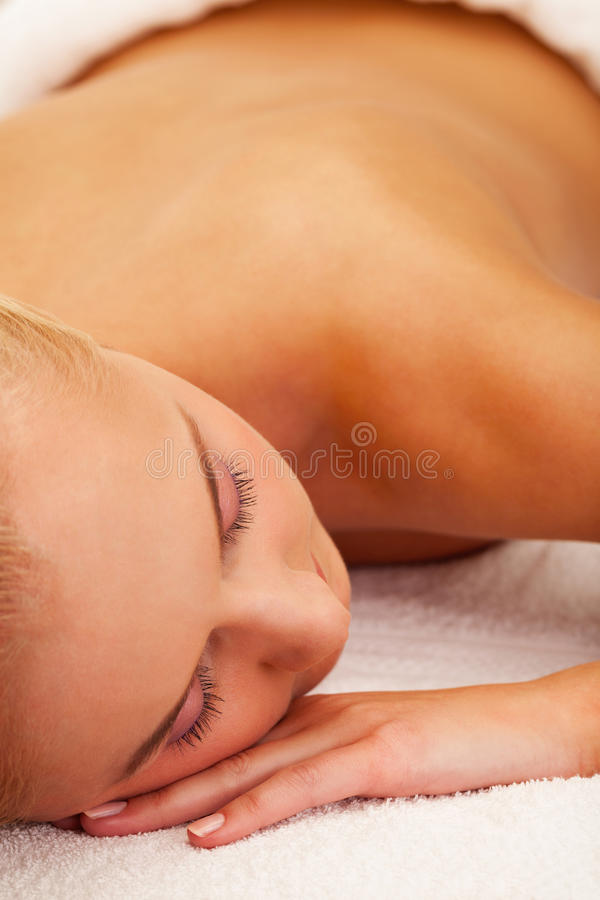 Spa relax. Girl relaxed in spa salon stock photos