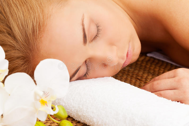 Spa relax. Girl relaxed in spa salon stock images