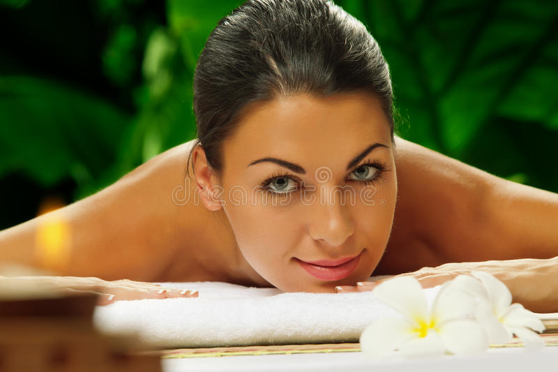 Spa relax. Portrait of young beautiful woman on color back stock photos