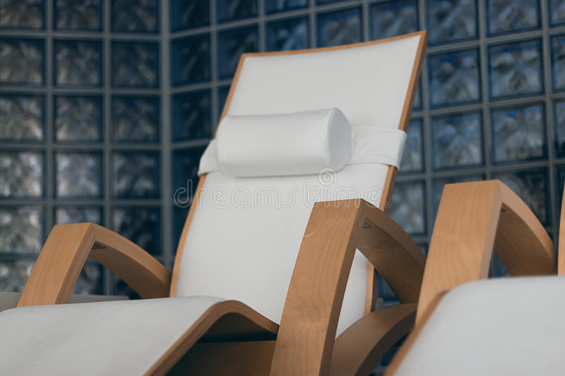 SPA relax room interior, with comfortable wooden loungers. Luxury spa with wooden loungers royalty free stock image