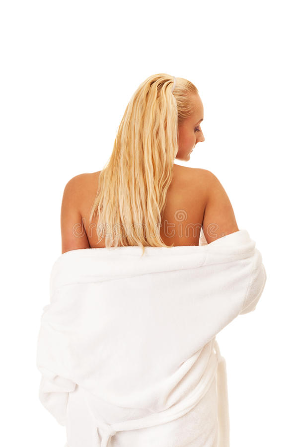 Spa relax. Woman in bathrobe on isolated white stock image