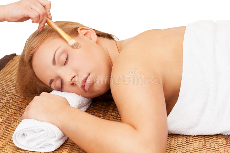 Spa relax. Woman enjoys spa with cosmetics royalty free stock images