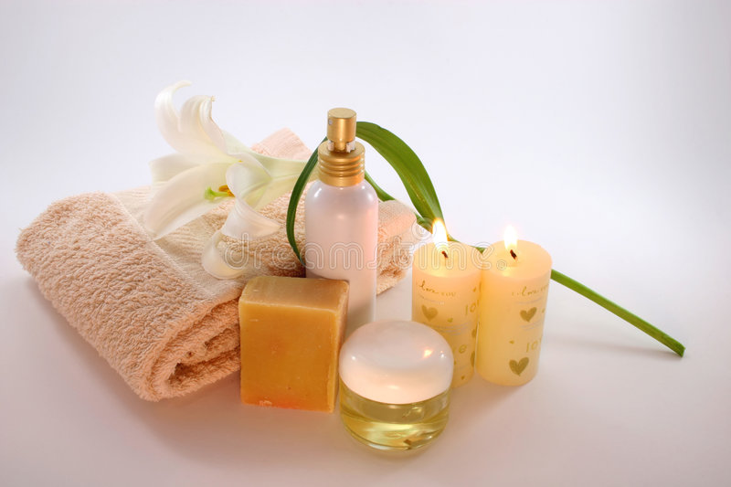 Spa Set #20. A set of softly lit spa objects - a white lilly flower, towel, massage oils and candles royalty free stock photos