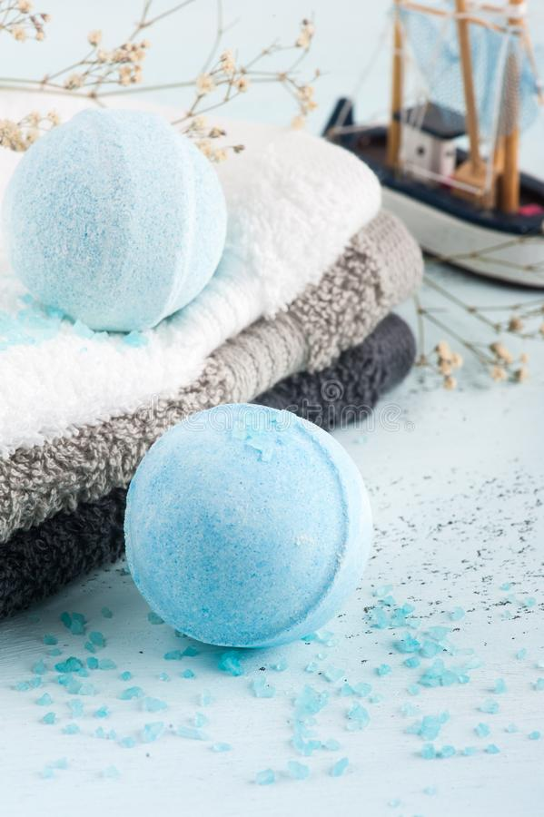 Spa set with blue bath bombs. And towels stock photo