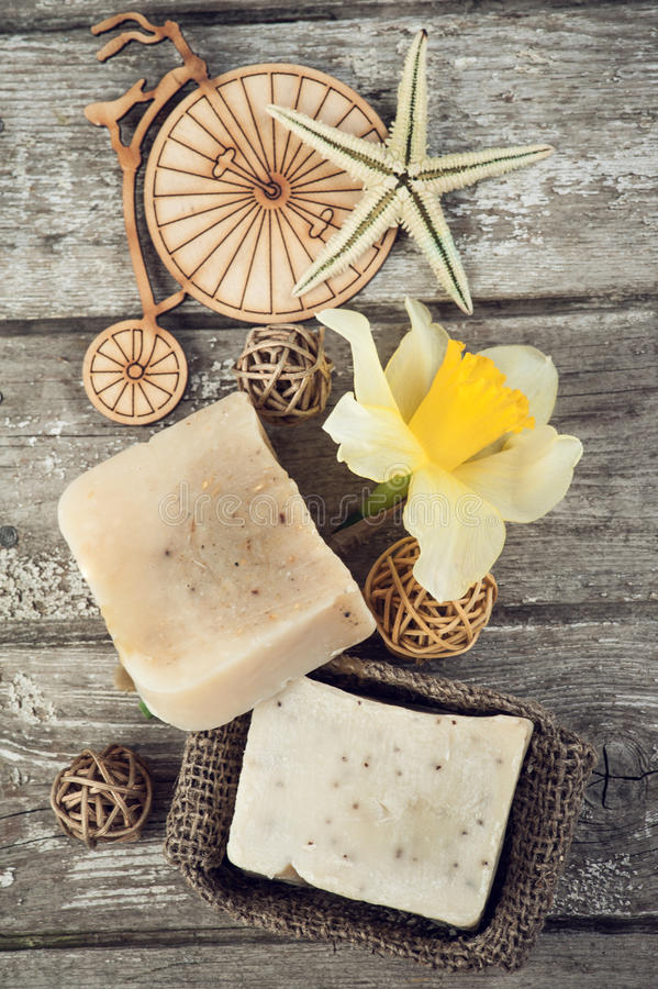 Spa set with handmade soap. Yellow flower and sea stars over white wood background royalty free stock images