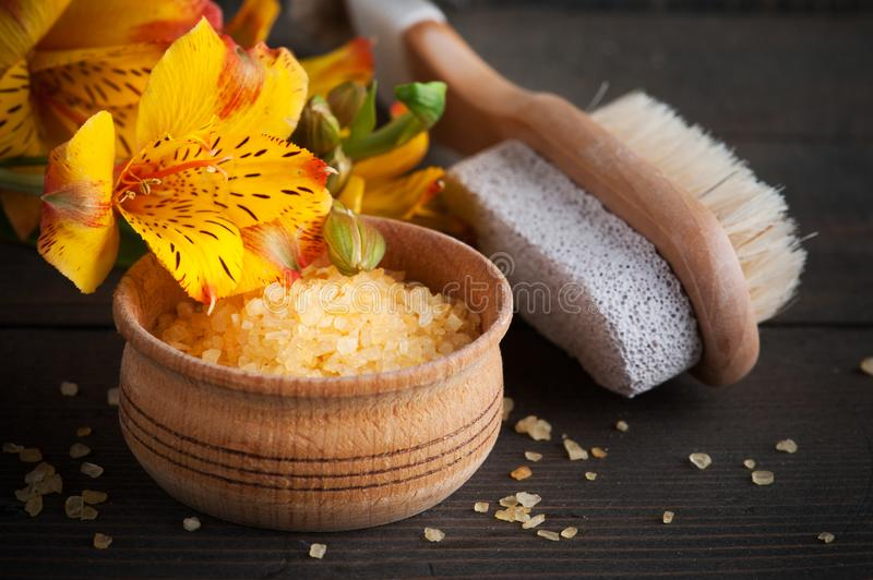 SPA set with yellow lilly, bath salt royalty free stock photography
