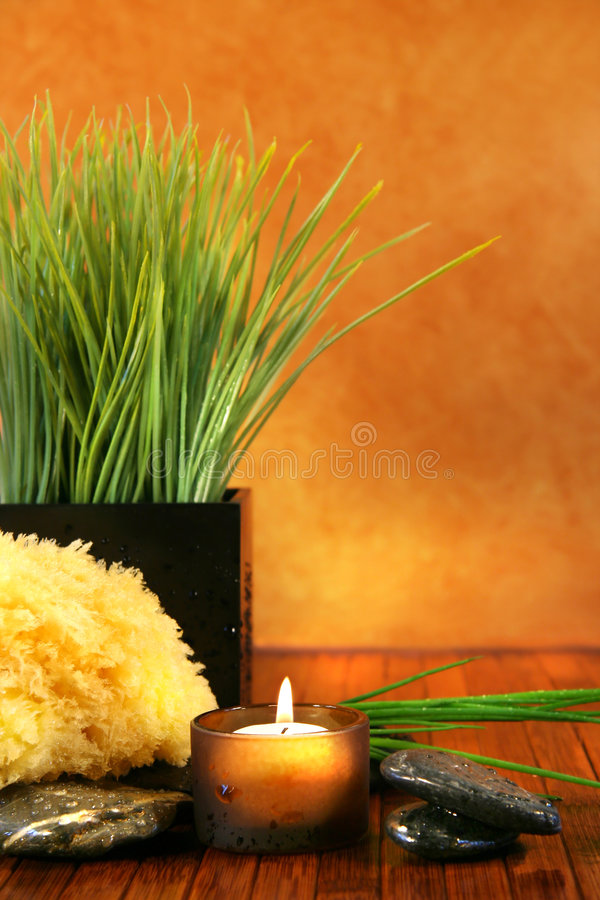 Spa setting with candle. Sponge and herb grass