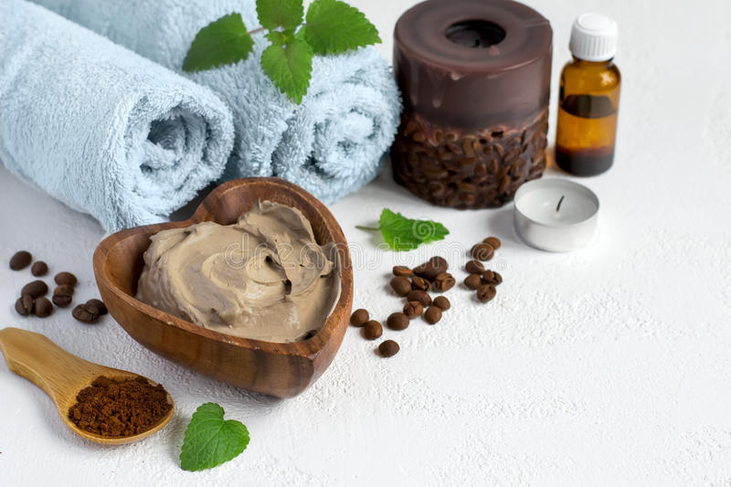 Spa setting with cosmetic clay mask for body, Towel Essential o stock images
