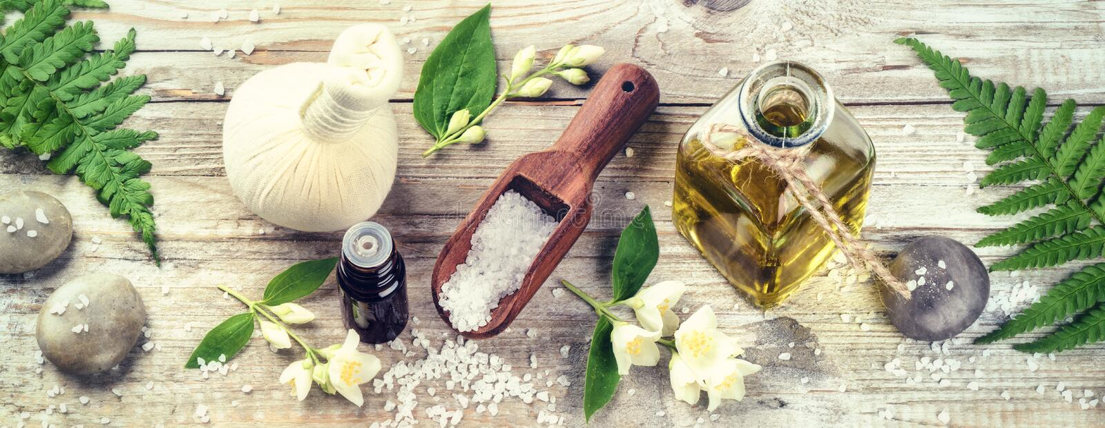 Spa setting with jasmine essential oil and flowers. Wellness con royalty free stock photos
