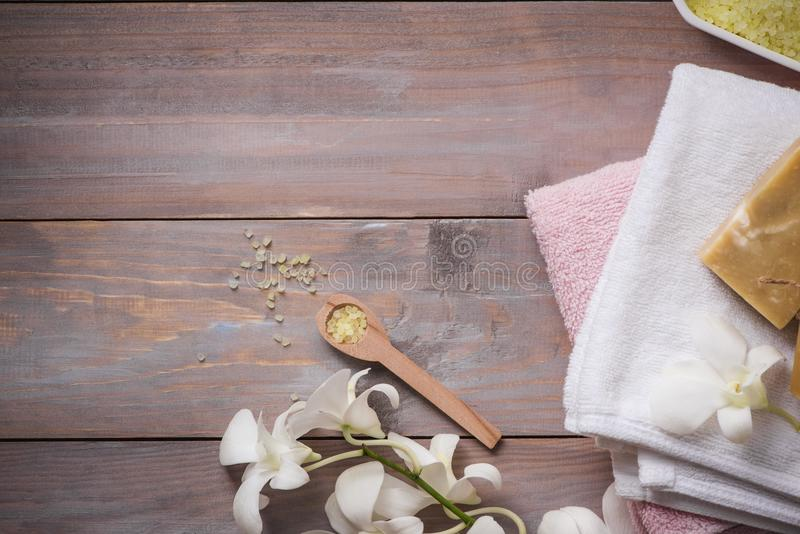 Spa setting with orchid, spoon,towel, soap, salt stones on old w royalty free stock image