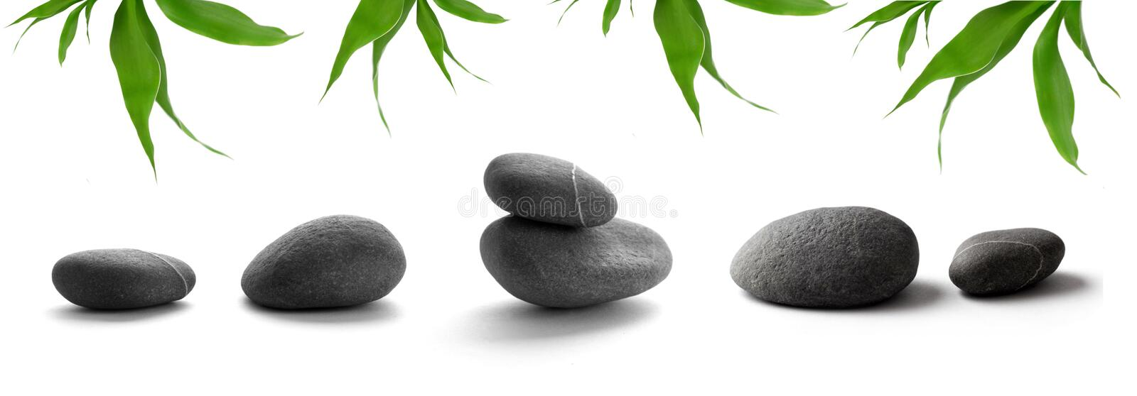 SPA still life. Zen-like stones. pebbles and bamboo leaves on white background royalty free stock photos
