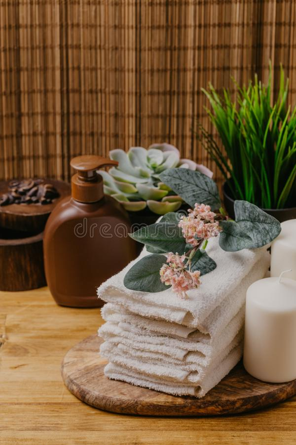 Spa still life with aromatic candles, flower and towel. - Imag royalty free stock photo