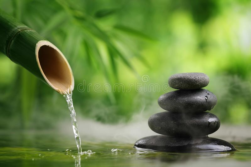 Spa. Still life with bamboo fountain and zen stone
