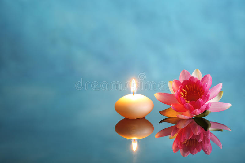 Spa. Still life with burning candle and pink lotus