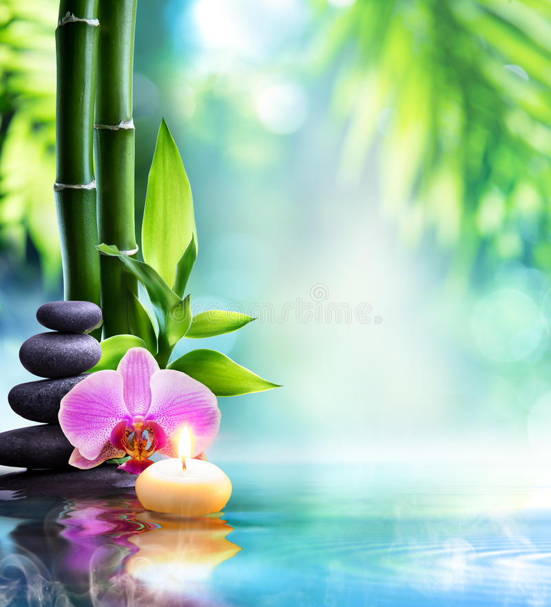 Spa still life - candle and stone with bamboo. In nature on water stock image