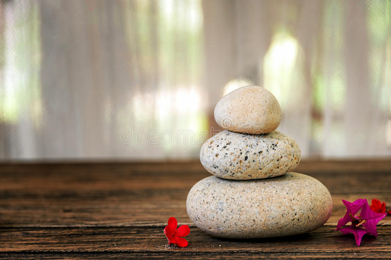 Spa still life with flowers, zen stone and essential oil stock image