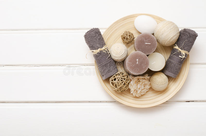 Spa still life - a soap and towels on a wooden background stock photo