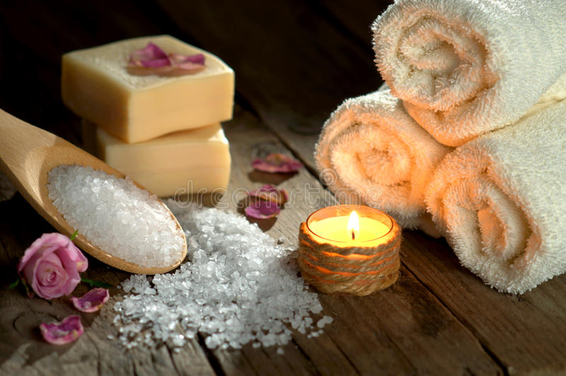 Spa still life with towels and candle. On wooden ground stock photo