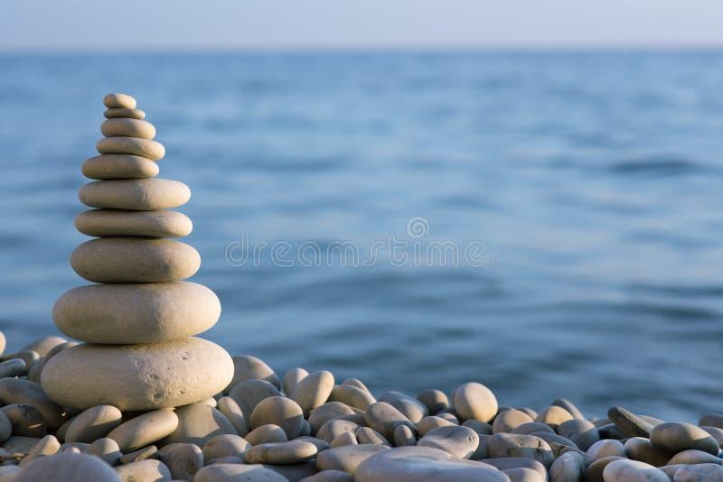 Spa stone on sea coast royalty free stock photography