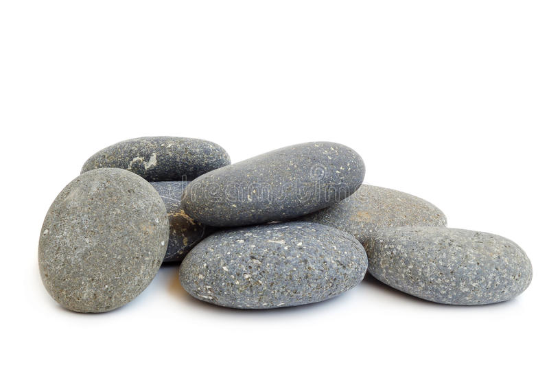 Spa stones. Stack of black stones for hot stones spa treatment on white background stock images