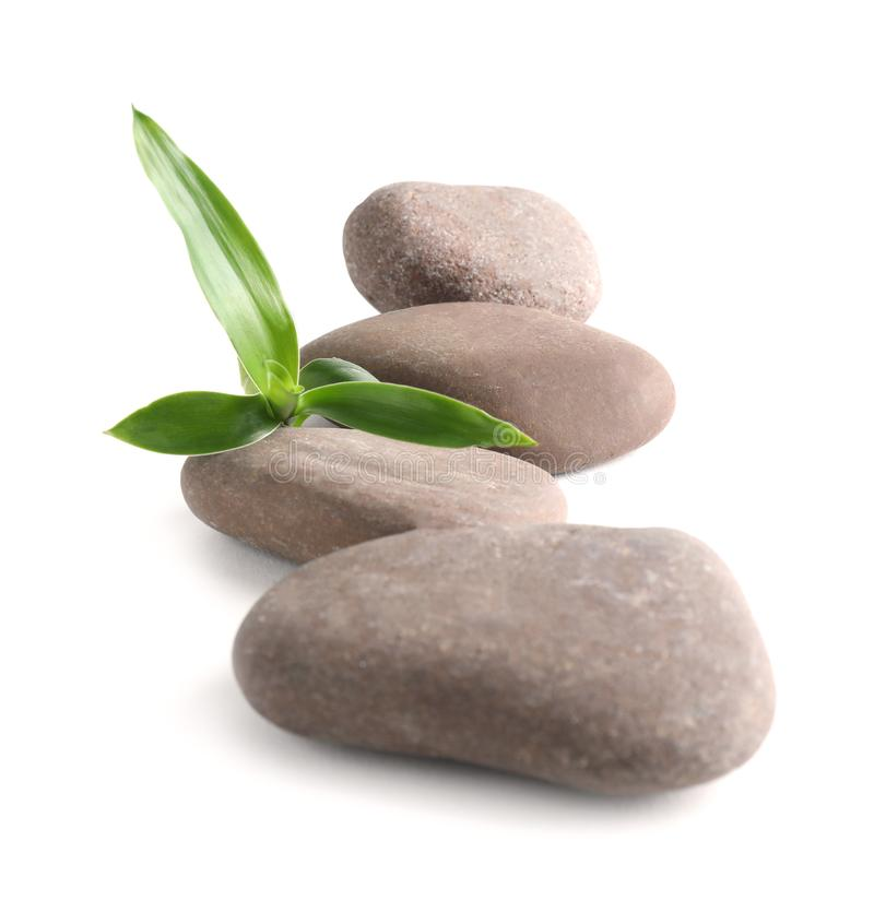 Spa stones with bamboo on white stock photo