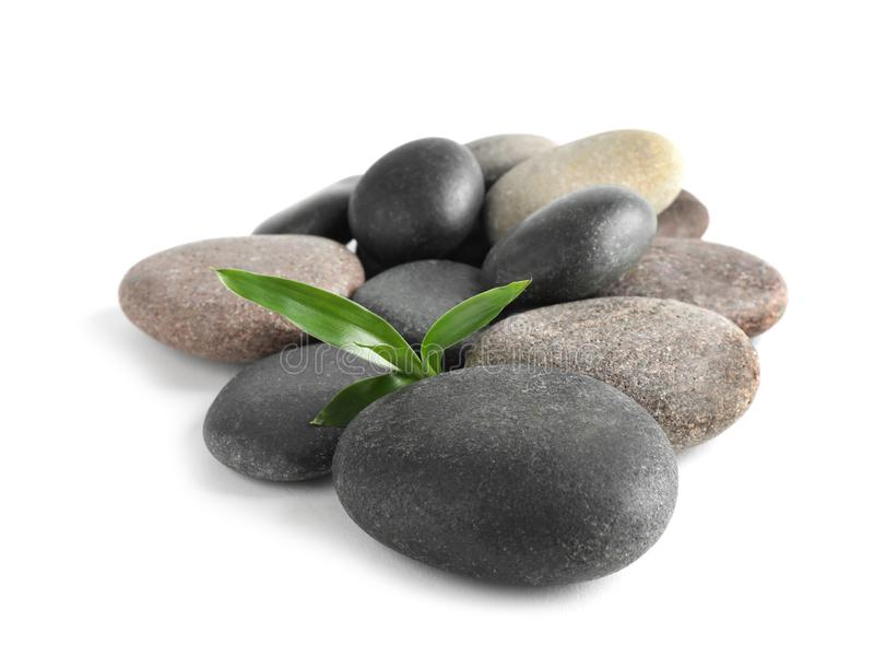 Spa stones with bamboo on white royalty free stock photo