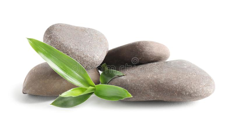 Spa stones with bamboo on white stock image