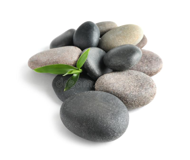 Spa stones with bamboo on white royalty free stock photos