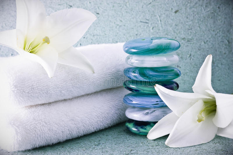 Spa stones and lilies. With towels stock photo