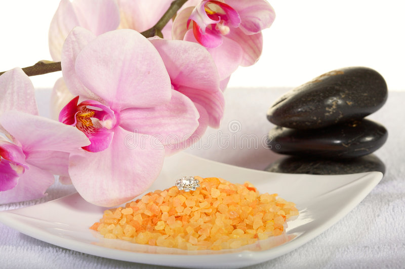 Spa stones with orchid and bath salt royalty free stock photo