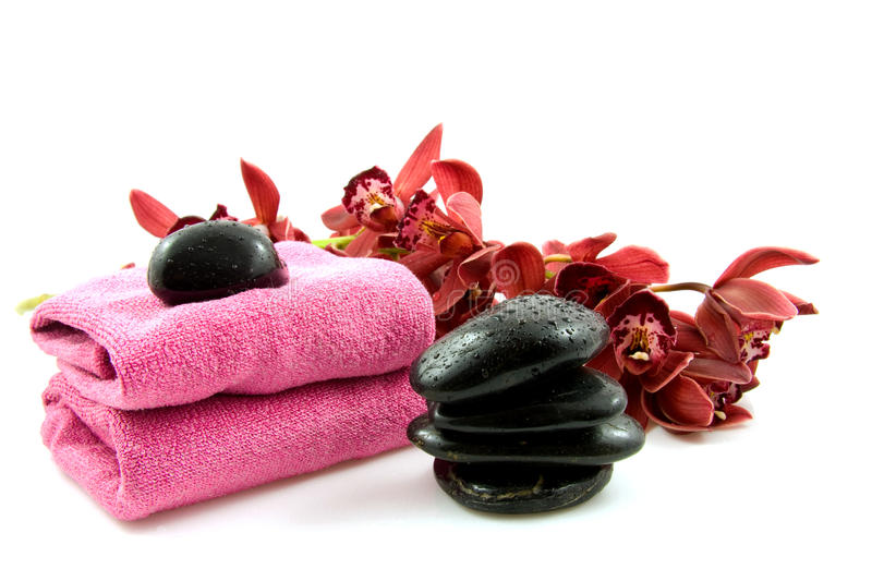 Spa stones with red orchid royalty free stock image