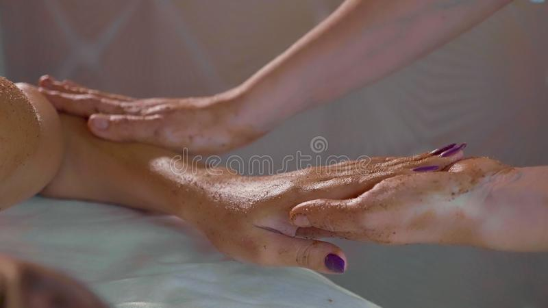 Portrait of young beautiful woman at skin care spa salon, close-up slow motion. stock photo