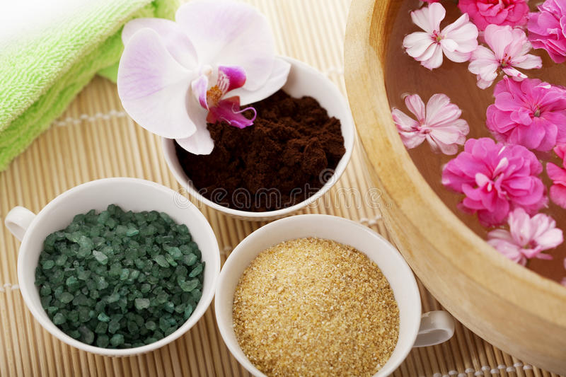 Spa therapy. Flowers in water, on a bamboo mat stock image