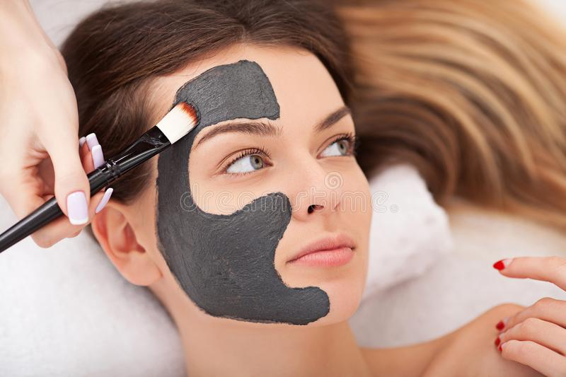 Spa therapy for woman receiving facial mask.  royalty free stock image