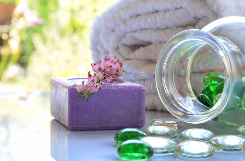 Spa toiletries. Soap and spa toiletries composition with glass pearls in natural light stock images
