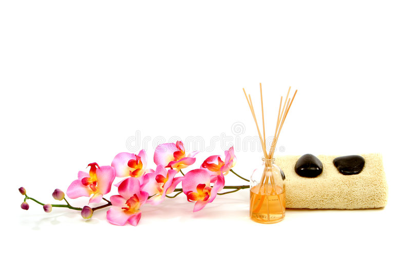 Spa towel, fragrance sticks, rocks and orchid