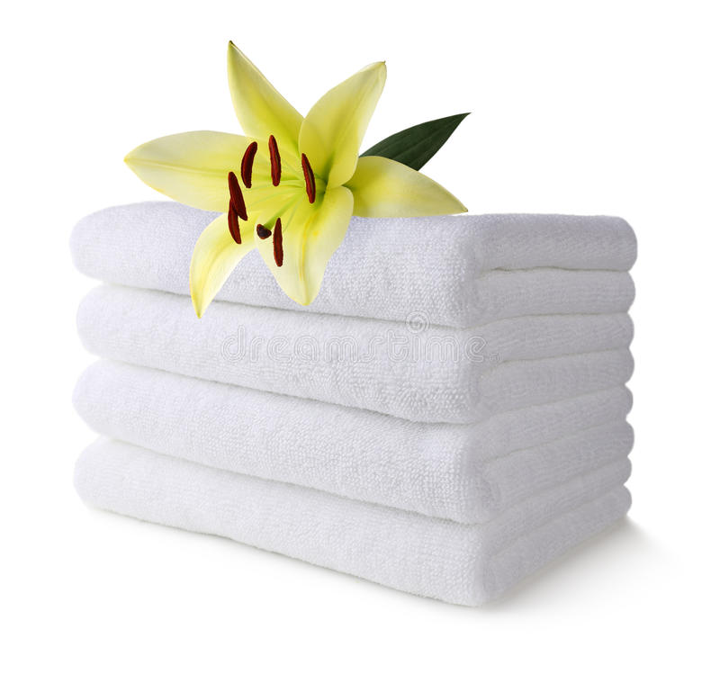 Spa towel with lily flower royalty free stock photo
