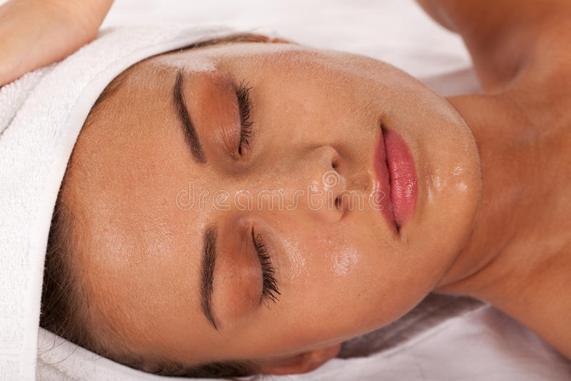 Spa treatment. Young girl with beads of perspiration in SPA center stock images