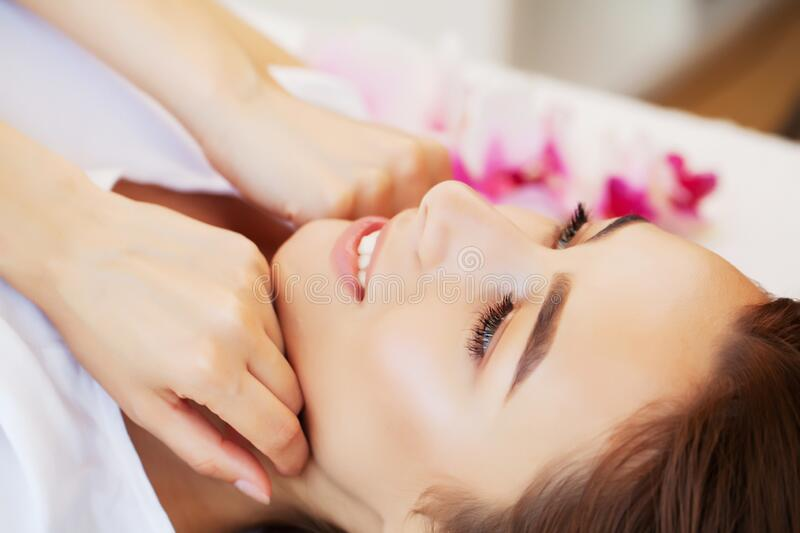 Spa treatment in beauty studio gets young beautiful woman relaxing stock photography