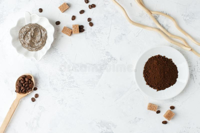 Spa treatment. Coffee organic sugar scrub on white background top view copyspace, nutrition wellness body scin care concept.  stock images