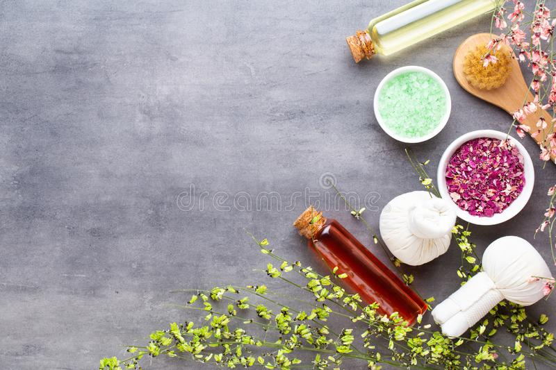 Spa treatment concept, flat lay composition with natural cosmetic products and massage brush, view from above, blank space for a royalty free stock photo