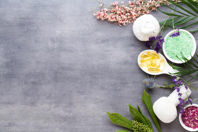 Spa treatment concept, flat lay composition with natural cosmetic products and massage brush, view from above, blank space for a stock photography