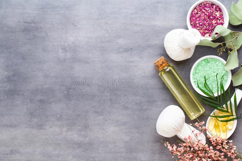 Spa treatment concept, flat lay composition with natural cosmetic products and massage brush, view from above, blank space for a royalty free stock images