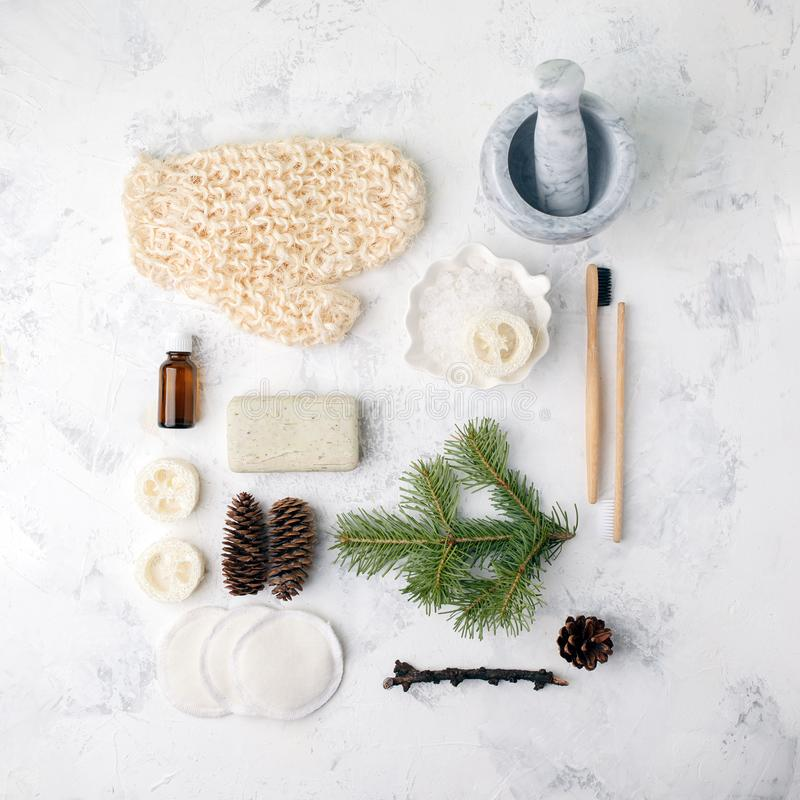 Spa treatment on light background. Spa accessories composition on white table. Natural aroma oil, sea salt, sisal, natural soap. stock photos