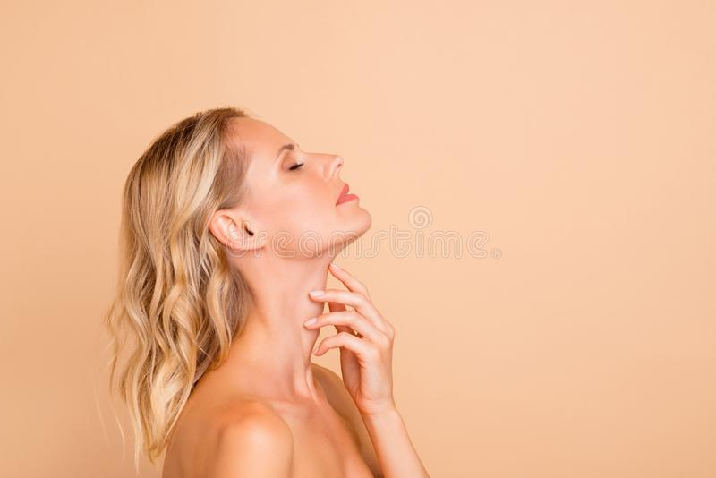 Spa treatment therapy. Profile side view portrait of attractive wavy-haired lady with perfect pure shine clean clear. Fresh smooth flawless skin copy space royalty free stock images