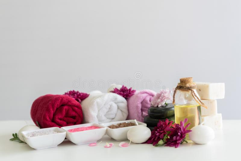 Spa treatments set on white wooden table. Healthcare and body therapy massage concept. Beauty and Healthy theme. Aroma, aromatherapy, background, ball, bath royalty free stock image