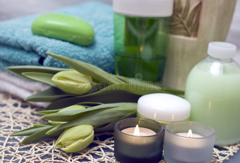 Spa tulips. Green bathroom items decorated with tea candles and green tulips