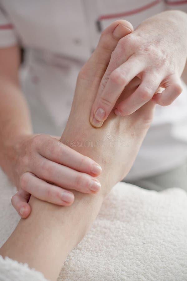 Spa and wellnes foot massage stock photos