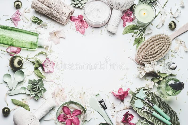 Spa and wellness background with flowers, skin cosmetic products and others body care and massage accessories on white background stock photos