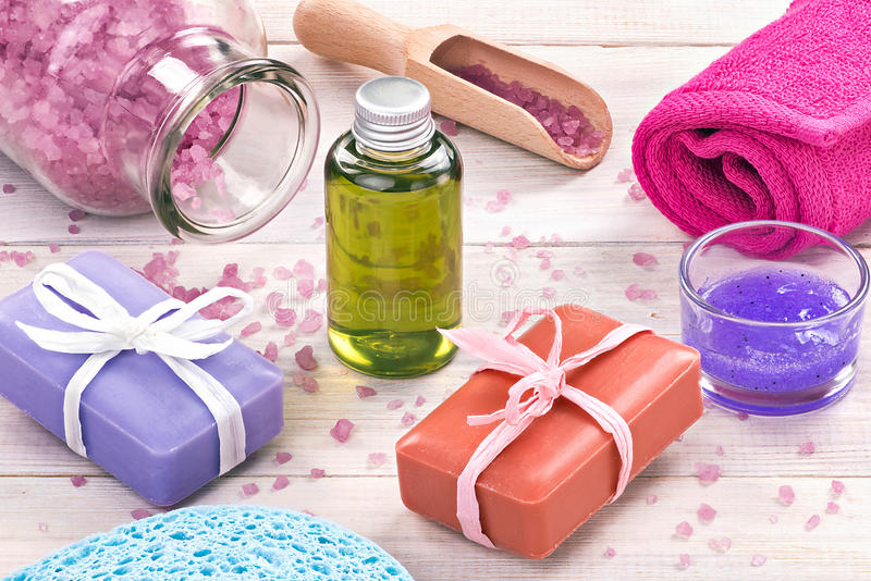 Spa and wellness concept. Cosmetics, salt and towel on white woo stock image